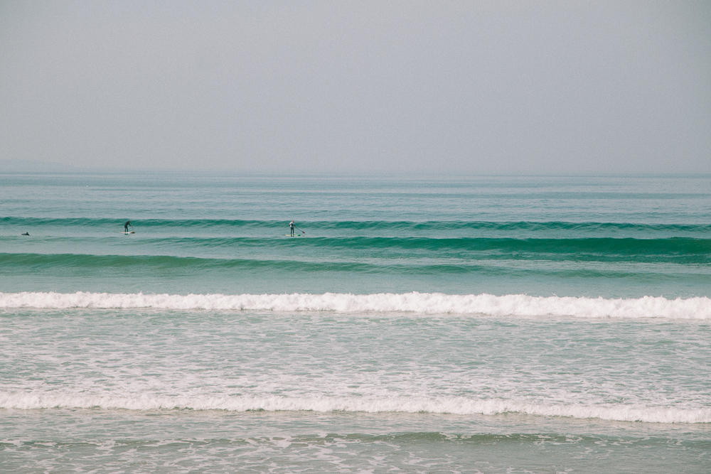 Surfers at Newgale Beach in Pembrokeshire