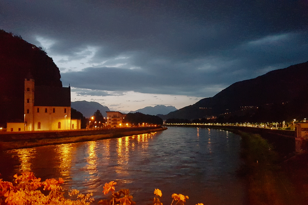 View over the river that runs through Trento at Night